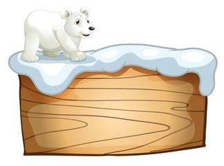 A polar bear above the empty wooden signboard