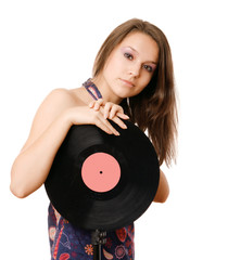 Party woman with vinyl disc as a microphone