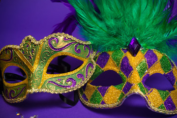 Wall Mural - Assorted Mardi Gras or Carnivale masks on a purple background