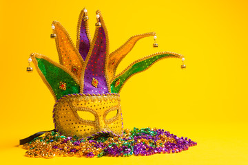 Wall Mural - Colorful group of Mardi Gras or venetian mask or costumes on a y