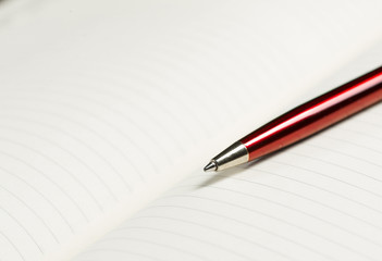 pen and open notepad