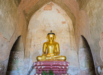 Ancient seated buddha statue in Bagan temple, Myanmar