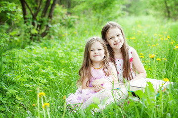 two cute sisters in the meadow