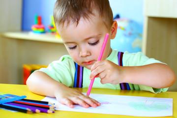boy paints paints