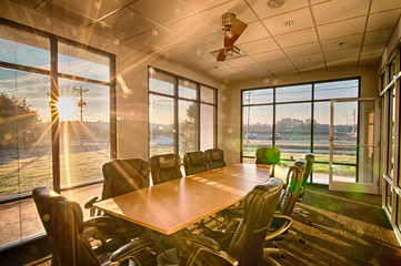well lit conference room with sun rays shining through