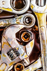 Rusty mechanic tools wrenches with grease stains