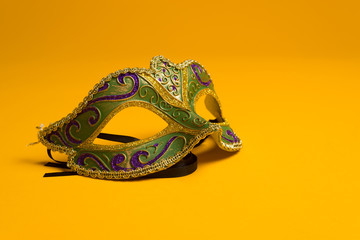 Wall Mural - Green and gold Mardi Gras, venetian mask on Yellow background