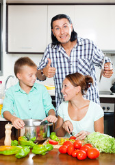 Happy family cooking food together