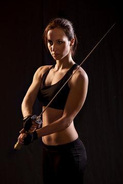 Young Woman Holding Samurai Sword.