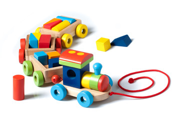 Wooden toy train on white