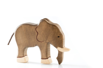 Wooden toy elephant figurine on white