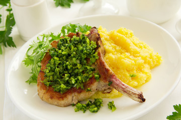 natural cutlet on the bone with polenta and gremolatoy.