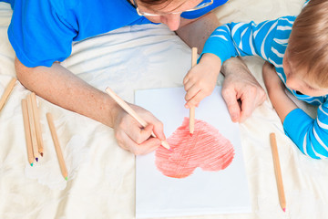 father and son drawing heart