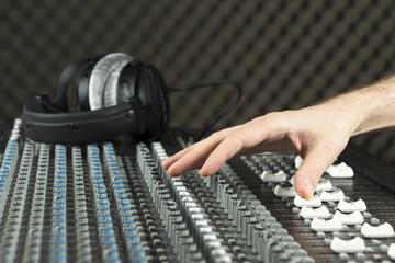 Hand on a studio mixer