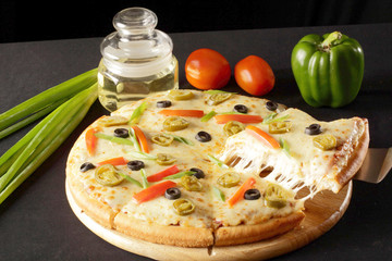 Delicious Vegetable cheese pizza.