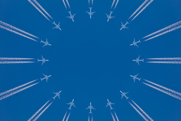 Circle of commercial airplanes against a blue sky