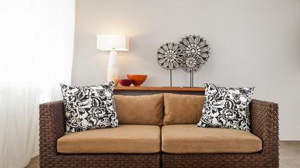 Beige brown sofa in interior setting