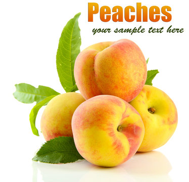 Ripe sweet peaches with leaves, isolated on white