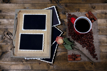 Composition with coffee cup and photo album,