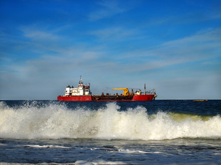 Red Workboat in Ocean