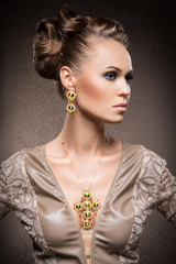 A rich woman in jewels of gold and stones on brown