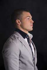 Profile view of handsome young man with shirt and jacket