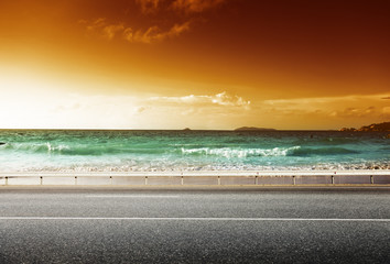 Wall Mural - road and sea in sunset time