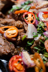 Close up Hot pan pork with tamarine chilil sauce.