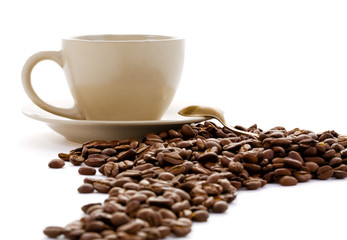 Cup and coffee grains isolated on a white background