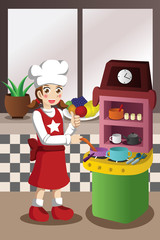 Girl playing with kitchen and cooking toy