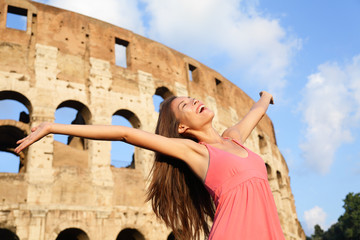 Wall Mural - Happy carefree elated travel woman by Colosseum