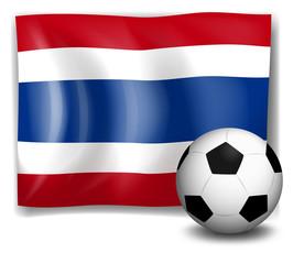 The flag of Thailand beside a soccer ball