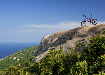 Mountain Bike over the Rock