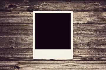 one polaroid vintage on wood