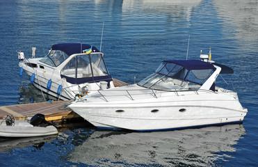 White motor yacht over harbor pier, Odessa, Ukraine