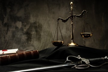 Scales, book and Sword of Justice on a judge's mantle
