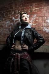 Fashion women street portrait  posing near brick wall