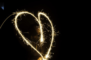 Sparkler heart on black background