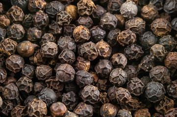 Black pepper grains as background