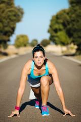 Female athlete ready for sprint running