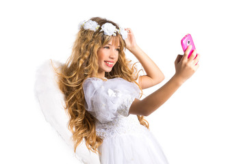 Angel blond girl taking picture mobile phone and feather wings
