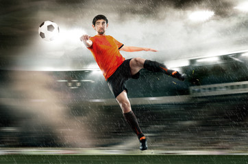 football player striking the ball at the stadium