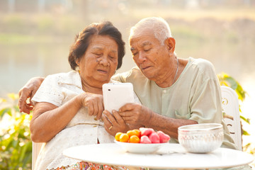 Senior couple using the tablet