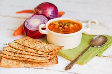 Minestrone soup on wooden background
