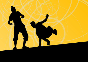 Active young man and woman street break dancers silhouettes in a