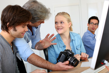 Teacher in class of photography with students