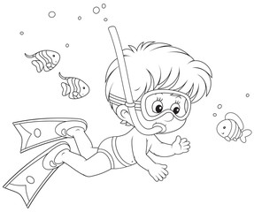 Boy diving among funny fishes