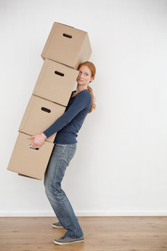 Moving Home - Woman Carrying Boxes