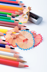 Sharpening different color pencils in a studio