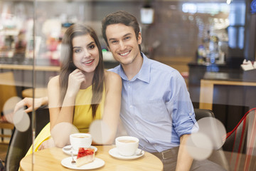 Portrait of beautiful couple in cafe